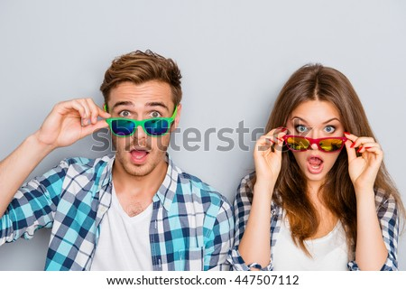 Wow! Surprised man and woman in glasses with open mouth
