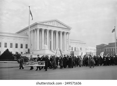 WPA protest march in front of the U.S. Supreme Court, Jan. 16, 1937. A multiracial group of men and women demonstrated for expansion of the WPA.