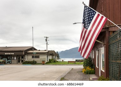 Wrangell, Alaska, USA - July 24, 2017: The United States Of America flag outside a store close to the city hall at the downtown.