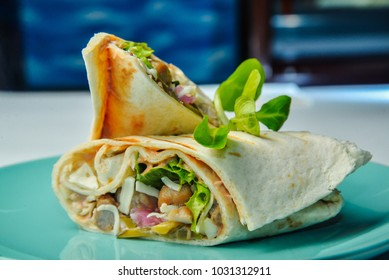 wrap with chicken and lettuce on closeup food background wallpaper
