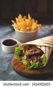 Wrap kebab with vegetables and french fries