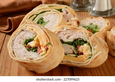 A wrap sandwich with turkey, cheese and lettuce