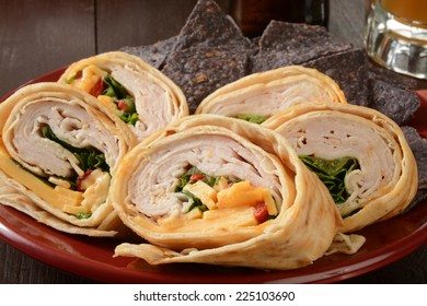 A wrap sandwich with turkey or chicken and organic blue corn tortilla chips