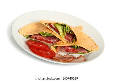 Wrap tortilla sandwich with ham, tomato, lettuce. Isolated with clipping path.