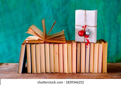 wrapped book as christmas gift,christmas decoration with books,reading,literature concept