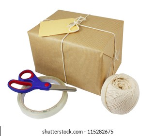 Wrapped box with label, sticky tape, scissors and string