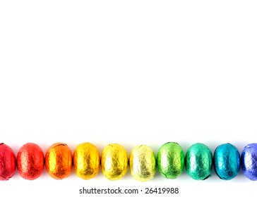Wrapped chocolate eggs in a row.
