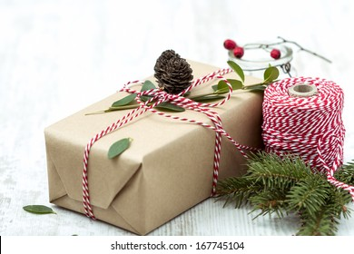 Wrapped Christmas present on Wooden Background