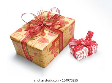 A wrapped Christmas presents with a colourful ribbon bow on a white background.
