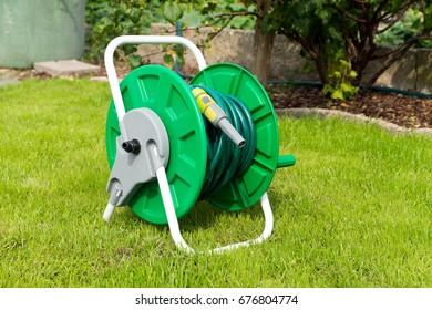 wrapped garden hose in a garden