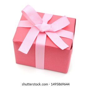 A wrapped red gift box isolated white