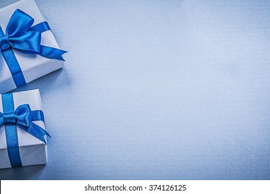 Wrapped resent boxes on blue background greeting card holidays concept.