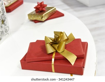 Wrapped slim presents in red paper