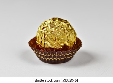 Wrapped sweet in golden foil.