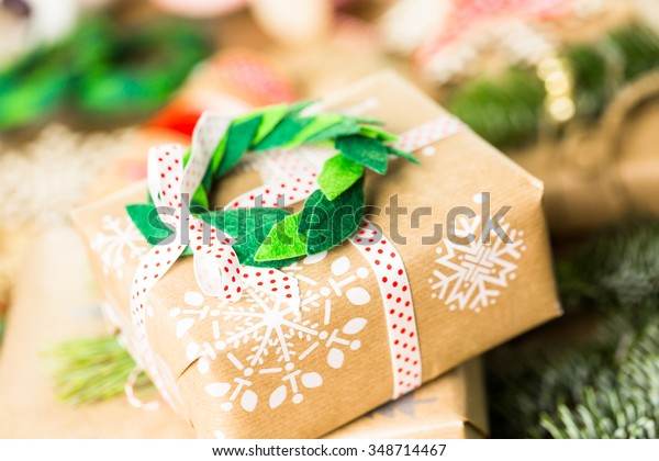 Wrapping Christmas gifts in recycled brown paper with vintage style at home.