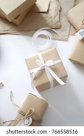 wrapping idea of christmas gifts, white background and interior, new year, craft paper, presents wrap, decoration, christmas essentials, holidays details, happy time, festive mood