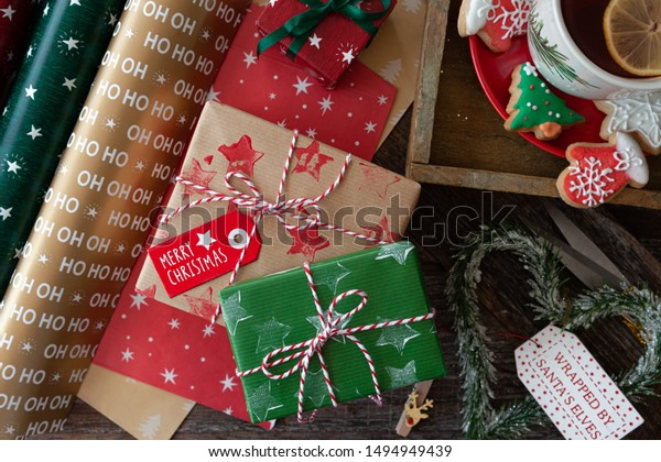 Wrapping little presents with colorful paper for Christmas holidays