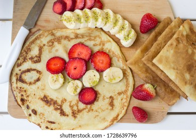 Wrapping pancakes with fresh fruit