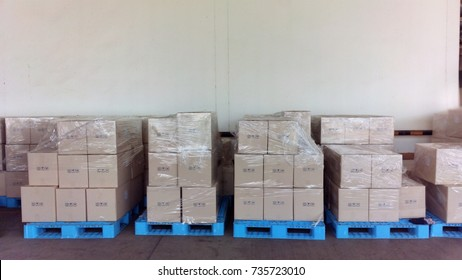 wrapping plastic film on box to prevent moving box in logistics operation process
