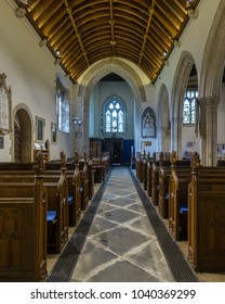 Wraxall, England - Feb 10, 2018: All Saints Church Nave view from Rood Screen, Religious Architecture