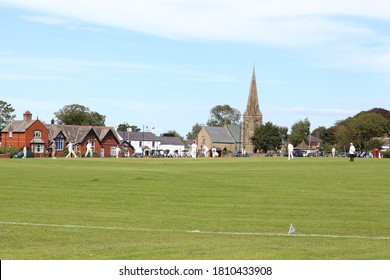 Wrea Green, Lancashire, UK - August 8 2020: Cricketers play a game on the village green on a summers day in August, 2020.