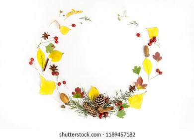 Wreath from autumn leaves, cones, anise on white background. Autumn concept.Flat lay, copy space, mockup