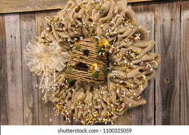 A wreath with bees and burlap