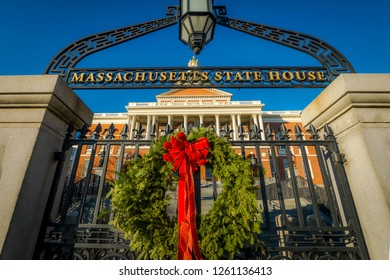 A wreath decorates the gates in front of the Massachusetts State House