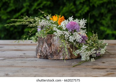 Wreath from  flowers on wooden background. Midsummer in Latvia. Celebration of Ligo feast in June