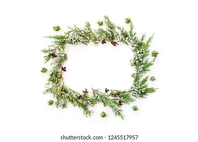 Wreath frame made of fir winter evergreen plants and natural cones. Flat lay. New year concept.