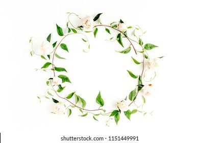 Wreath frame made of green branches, leaves and peonies isolated on white background. lay flat, top view