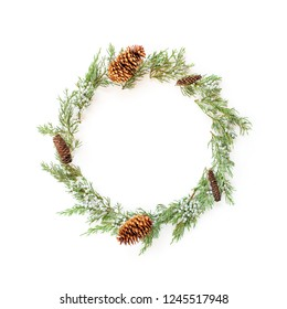 Wreath frame made of winter evergreen plants and natural cones. Flat lay Christmas concept.