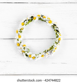Wreath made of daisy flowers. Top view, flat lay, square