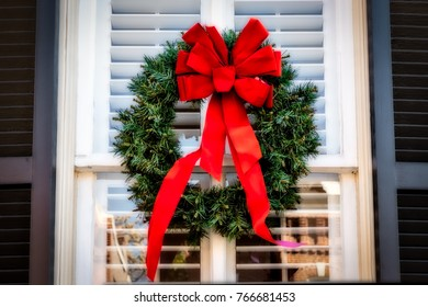 A wreath on a window with shutters on a northern Virginia street.