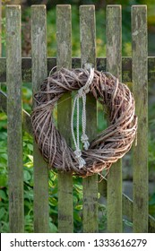Wreath plaidet out of straw as door decoration