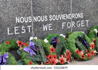 Wreaths in cenotaph with Lest We Forget sign