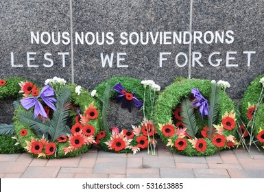 Wreaths in front of Lest We Forget sign
