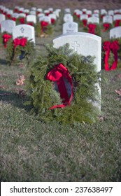 Wreaths placed at a national military cemetery as part of a Wreaths Across America event
