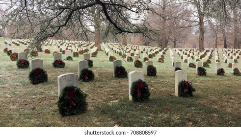 Wreaths placed on Graves by volunteers at Arlington National Cemetery  on December 16,2016  with light snow cover