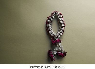 Wreaths of wilted old flowers on a white background with space and look sad.