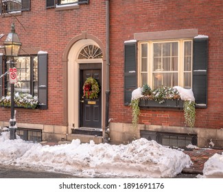 Wreaths and window boxes covered in snow on Beacon Hill in Boston