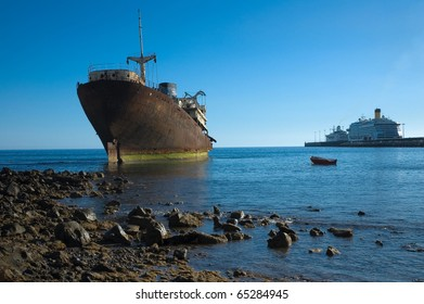 Wreck and modern ships in Arrecife, Lanzarote, Canary Islands