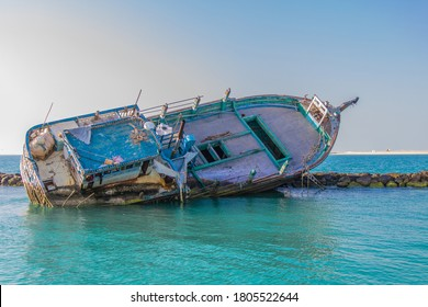 Wreck on the breakers of the World, Dubai. Dhow.