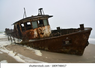 Wreck of a trawler that ran aground in 1976 on the beach off the Atlantic Ocean in the Namib Desert
