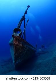 wreck underwater scuba divers around