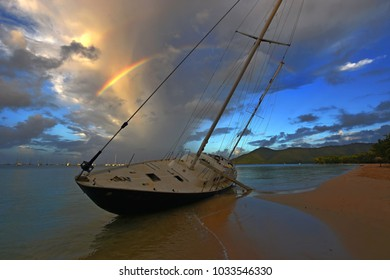 Wreck of a yacht with a rainbow