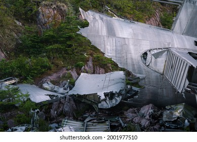 Wreckage of a B36 Bomber from world war 2, crashed atop a mountain in Burgoynes Cove, Trinty Bay, Newfoundland. The metal remains of the hull and wings of the ship can be seen, like a carcass.