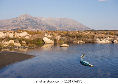 A wrecked boat on a lake at sunset in Samothrace island, Greece