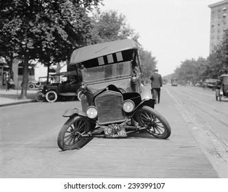 Wrecked car on Washington, D.C. street in 1922.