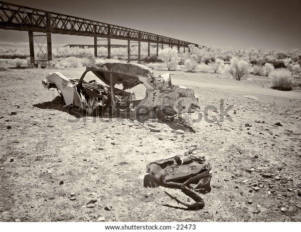Wrecked car in riverbed, Algebuckina Bridge, Old Ghan railway, Oodnadatta Track, Outback Oz.